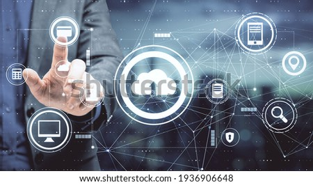 Data storage concept with businessman pushes button on touch screen with cloud service icons. Double exposure Photo stock ©