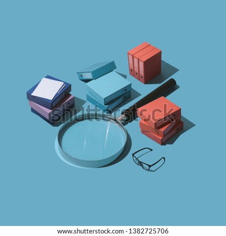 Database and archive management: big magnifying glass and piles of folders, isometric objects #1382725706
