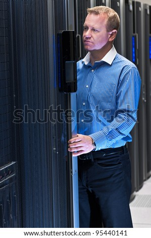 Datacenter administrator working on a large scale computer cluster.