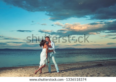 date and romance. date of sexy young couple in lobe kissing on sunset beach in summer #1336518374