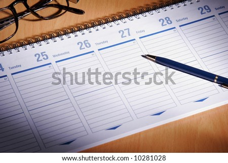 Date book on desk with glasses