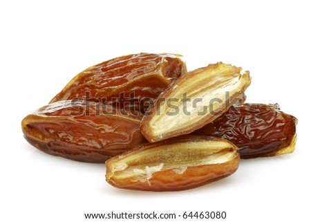date fruit and a cut one on a white background