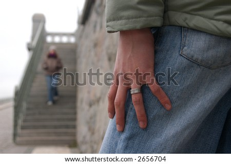 Date. Hand of a young man waiting for a girl going down to the steps