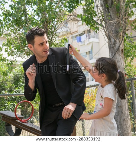Date: 17/5/2015. Location: Park in Athens Greece. Magic trick wand falls down and brakes suddenly when the kid takes it at a Magic show.