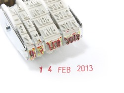 Date months years stamper on a white background.