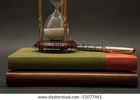 datebook,hourglass and pen