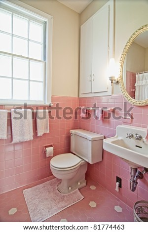 Pink Bathroom Ideas on Dated Bathroom With Pink Tile And White Wood Stock Photo 81774463