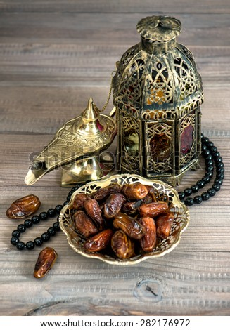 Dates arabic lamps and rosary Islamic holidays concept Festive decoration