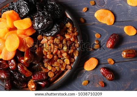 Dates, dried apricots, prunes, raisins #1038710209