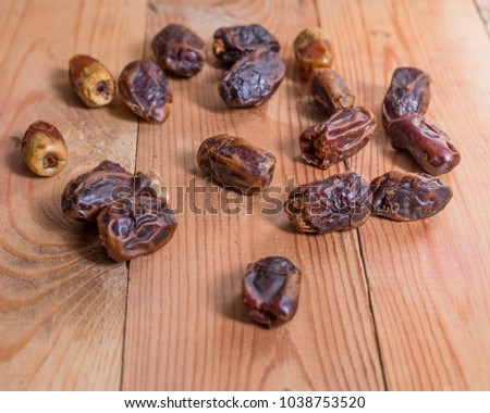 dates fruits on the wooden table #1038753520
