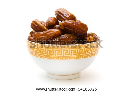 dates in cup isolated on white