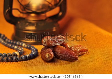 Dates,lantern and rosary still life