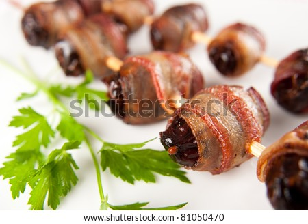 Dates Wrapped in Bacon and Baked