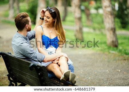 Dating couple sitting on bench #648681379
