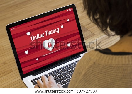 dating online concept: online dating website on a laptop screen. Screen graphics are made up. #307927937