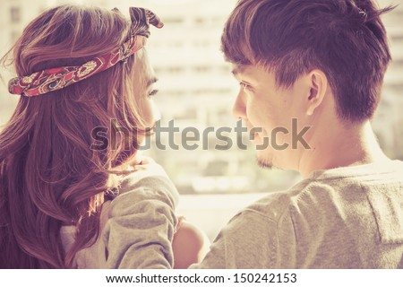 Dating young couple in love facing