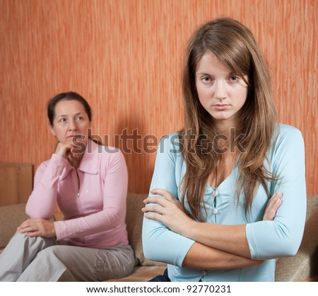daughter and mature mother having quarrel at home