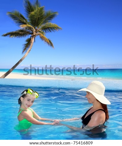 daughter and mother in swimming pool tropical location background [Photo Illustration]