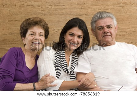 Daughter enjoying with her mature Mother and Father - stock photo