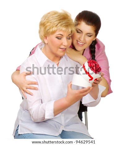 Daughter give gift to her mother isolated