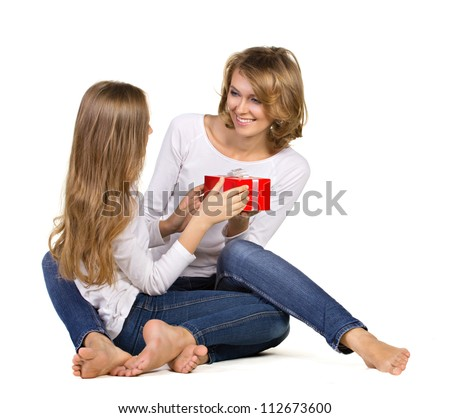 daughter gives gift to mother isolated on white