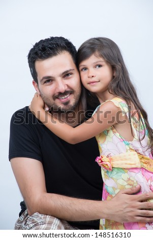 Daughter hugging her dad