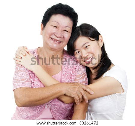 Daughter hugging her mother.