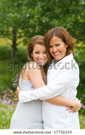 Daughter Hugging Mother For Mother's Day - stock photo