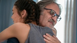 Daughter hugs his own father