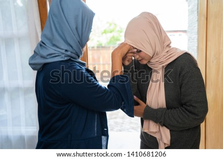 daughter kissed his mother hand a sign of affection on Eid day