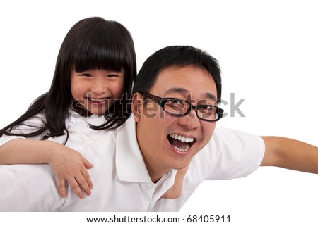 Daughter on  father's shoulders having fun - stock photo