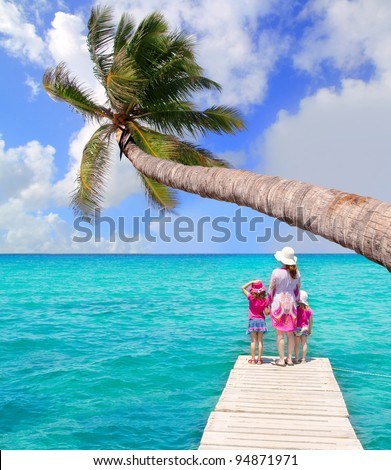 Daughters and mother in jetty on Formentera with turquoise sea [photo illustration]