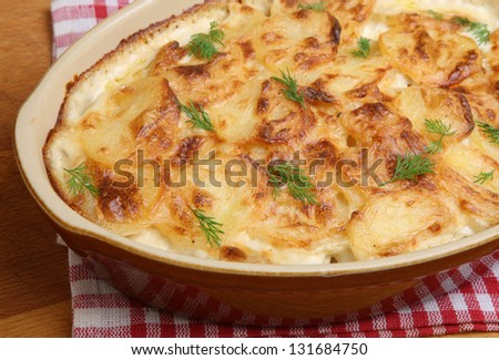 Dauphinois potatoes in ceramic casserole dish.