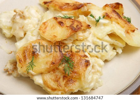 Dauphinois potatoes served on a plate.