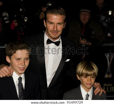 David Beckham and sons  Brooklyn and Romeo arriving for The Sun Military Awards 2011 at the Imperial war Museum, London. 19/12/2011 Picture by: Simon Burchell / Featureflash
