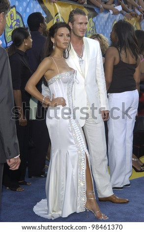 DAVID BECKHAM & VICTORIA POSH SPICE BECKHAM at the 2003 MTV Movie Awards in Los Angeles. May 31, 2003