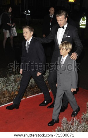 David Beckham with sons, Brooklyn and Romeo arriving for The Sun Military Awards 2011 at the Imperial war Museum, London. 19/12/2011 Picture by: Steve Vas / Featureflash