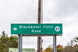 Davis, West Virginia and sign on road for Blackwater Falls 29 street in Canaan valley area with background text for telemedicine in USA fall season