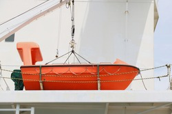 Davit lifeboat, Rescue boat or lifeboat of Cargo ship moored alongside in shipyard and the boat on mounting bracket.