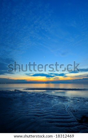 dawn at the beach during low tide