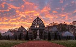 Dawn at the famous greenhouse in Parc de la Tete D' Or (park of the golden head) in Lyon, France.
