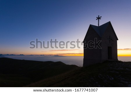Dawn at the little church, mount Grappa landscape, Italy. Italian alps panorama Stock fotó ©