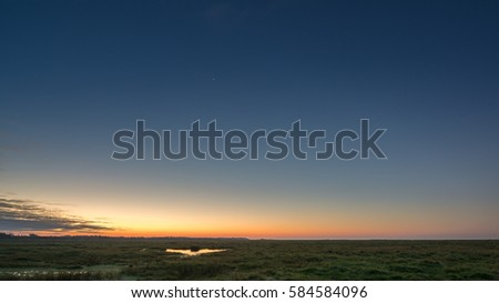 dawn at the mudflats of Sankt Peter Ording in Germany #584584096