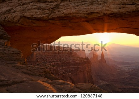 Dawn at Utah's iconic Mesa Arch in Canyonlands National Park near Moab.