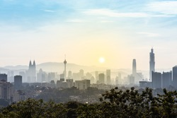 Dawn in Kuala Lumpur with all major iconic sky scrapers and major buildings visible in frame