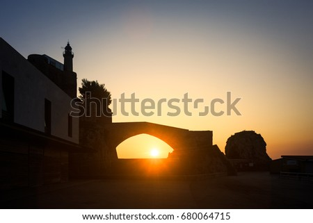 Shutterstock Dawn in the port of Castro Urdiales, the sun rises below the Roman bridge, Castro Urdiales, Cantabria