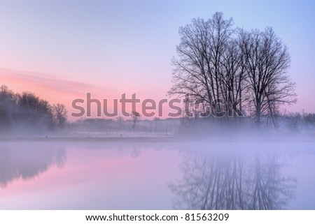 Dawn landscape of Jackson Hole Lake with reflections in calm water, Fort Custer State Park, Michigan