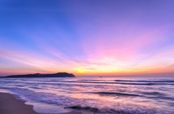 Dawn on the beautiful beach with full of purple colors in the sky welcomes the beautiful new day