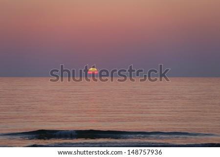 stock-photo-dawn-on-the-mediterranean-with-sun-rising-above-horizon-148757936.jpg