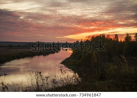 Dawn on the Nerl River on the background of the autumn countryside, Vladimir Region, Russia #734961847